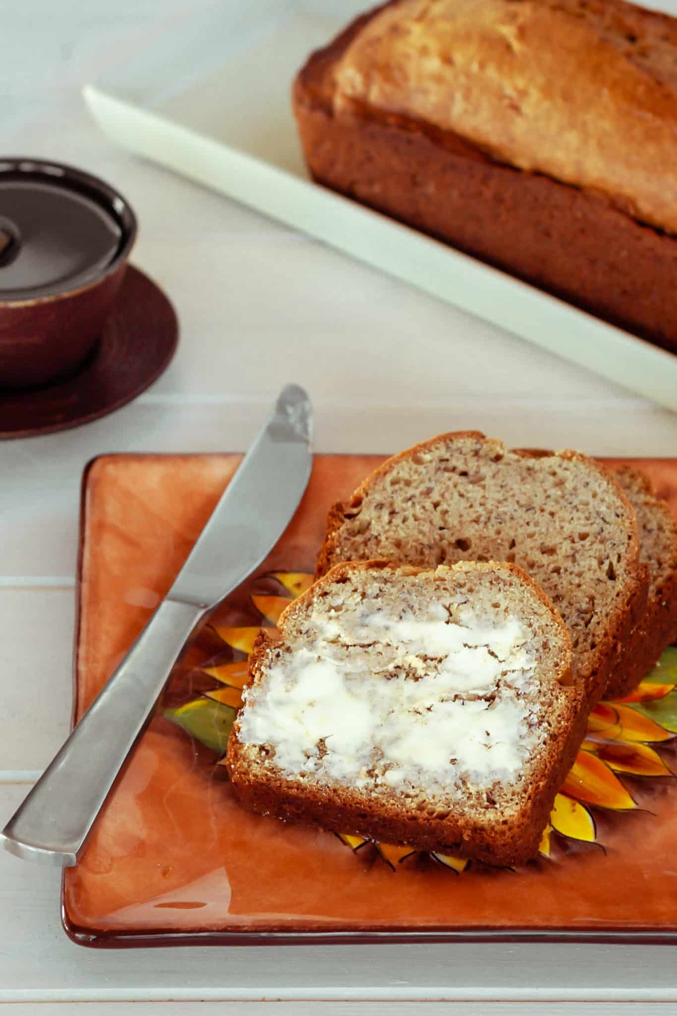Delicious slices of banana bread topped with butter.