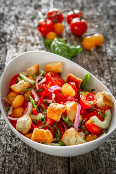 Colorful tomatoes salad in a bowl
